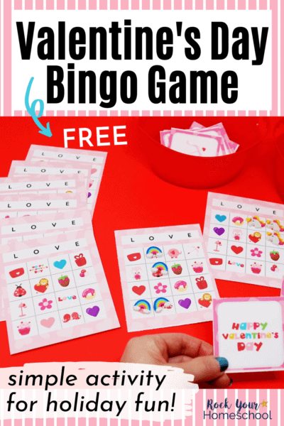 Woman holding Valentine's Day bingo game calling card with set in the background to feature the amazing holiday fun you'll have with your kids