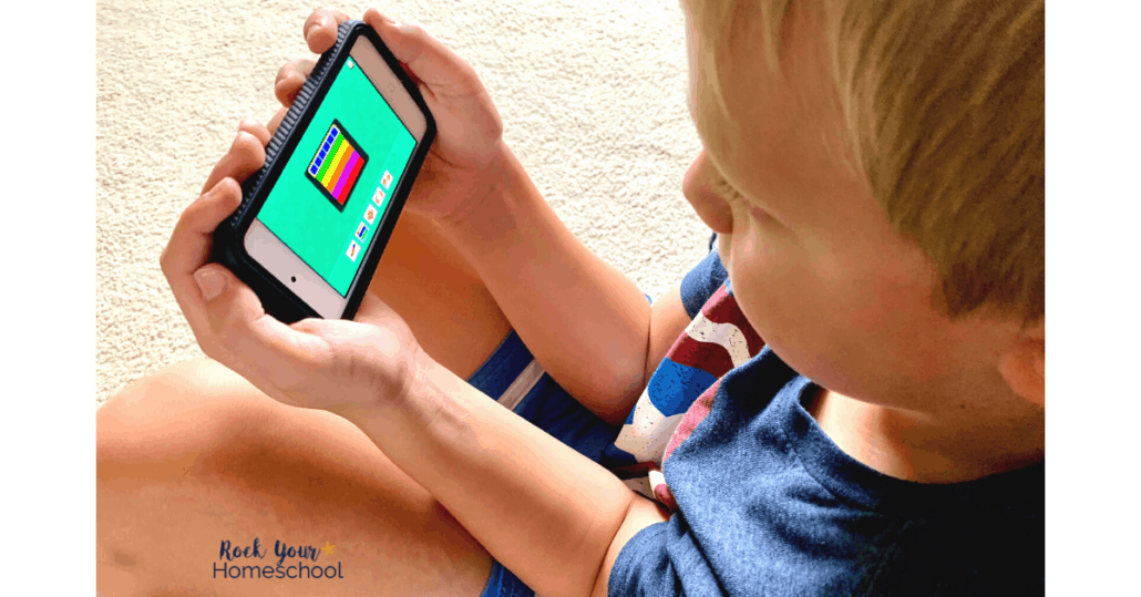 Young boy using iPod to learn with the Starfall app